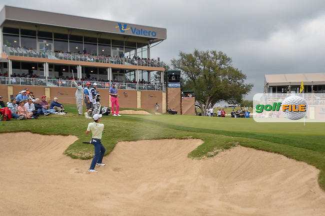 Joaquin Niemann (CHL) hits from the trap on 18 during Round 3 of the Valero Texas Open, AT&T Oaks Course, TPC San Antonio, San Antonio, Texas, USA. 4/21/2018.<br /> Picture: Golffile | Ken Murray<br /> <br /> <br /> All photo usage must carry mandatory copyright credit (© Golffile | Ken Murray)