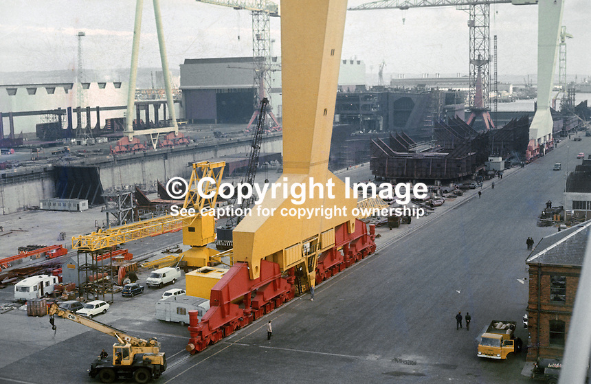 General view, shipyard, Harland &amp; Wolff, Belfast, N Ireland, UK. One of the legs of the massive Goliath crane is in the foreground. 197609290427c.<br />