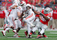 Ohio State Buckeyes defensive lineman Adolphus Washington (92) takes down Indiana Hoosiers running back Tevin Coleman (6) but gets called for a horse collar tackle in the second quarter of the college football game between the Ohio State Buckeyes and the Indiana Hoosiers at Ohio Stadium in Columbus, Saturday afternoon, November 22, 2014. As of half time the Ohio State Buckeyes led the Indiana Hoosiers 14 - 13. (The Columbus Dispatch / Eamon Queeney)