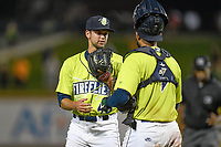 Closing pitcher Stephen Villines (40) of the Columbia Fireflies talks with catcher Ali Sanchez after earning the save in a game against the Greenville Drive on Friday, May 25, 2018, at Spirit Communications Park in Columbia, South Carolina. Columbia won, 3-1. (Tom Priddy/Four Seam Images)