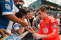 Philadelphia Union goalkeeper Zac MacMath (18) signs autographs after the match. The Philadelphia Union defeated Toronto FC 3-0 during a Major League Soccer (MLS) match at PPL Park in Chester, PA, on July 8, 2012.
