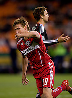 Brian McBride (20) of the Chicago Fire celebrates his goal at RFK Stadium in Washington, DC.  The Chicago Fire defeated DC United, 2-0.
