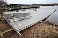 NWA Democrat-Gazette/DAVID GOTTSCHALK A new rowing dock is visible Monday, December 3, 2018, in the marina at Lake Fayetteville. The new 64 foot aluminum and composite decking dock will replace an older dock at the marina. The project was made possible through a $8,000 Rotary Club donation, $5,000 from the Rowing Club of Northwest Arkansas and $25,000 in parkland dedication fees. The Fayetteville Parks and Recreation Advisory Board on Monday considered adjusting the one-time fee the city charges to developers of new properties.