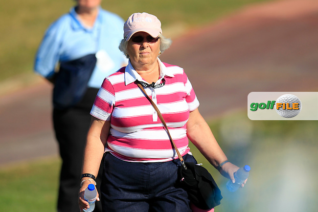 Damien McGrane's (IRL) mum Attracta follows him at the 9th tee during Thursday's Round 1 of the 2013 Portugal Masters held at the Oceanico Victoria Golf Club. 10th October 2013.<br /> Picture: Eoin Clarke www.golffile.ie