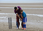 Local lad Davin O'Connor gets some tuition in how to hold a cricket bat at the beach cricket festival. Photo: Andy Spearman.