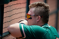Greensboro Grasshoppers designated hitter Cameron Baranek (7) in the dugout during a game against the Lakewood BlueClaws on June 10, 2018 at First National Bank Field in Greensboro, North Carolina.  Lakewood defeated Greensboro 2-0.  (Mike Janes/Four Seam Images)
