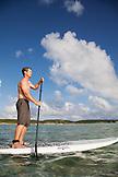 EXUMA, Bahamas. Grant doing stand up paddling at the Fowl Cay Resort.