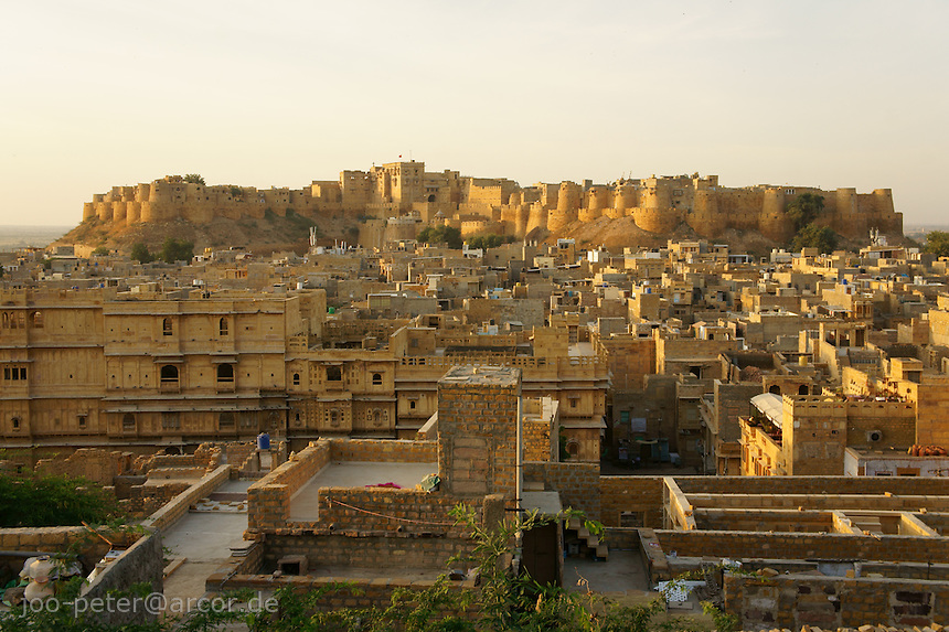 """Jaisalmer Fort and city view early in the morning. Jaisalmer is also called """"Golden city"""" because of the yellowisch sandstone."""