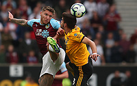 Wolverhampton Wanderers' Ruben Neves and Burnley's Jeff Hendrick<br /> <br /> Photographer Rachel Holborn/CameraSport<br /> <br /> The Premier League - Wolverhampton Wanderers v Burnley - Sunday 16th September 2018 - Molineux - Wolverhampton<br /> <br /> World Copyright &copy; 2018 CameraSport. All rights reserved. 43 Linden Ave. Countesthorpe. Leicester. England. LE8 5PG - Tel: +44 (0) 116 277 4147 - admin@camerasport.com - www.camerasport.com