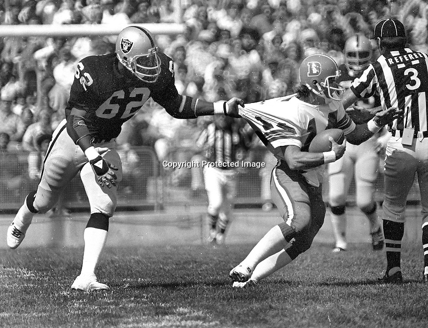 Oakland Raider #62 Reggie Kinlaw grabs Denver Bronco QB Norris<br /> Weese...(1979 photo/Ron Riesterer)