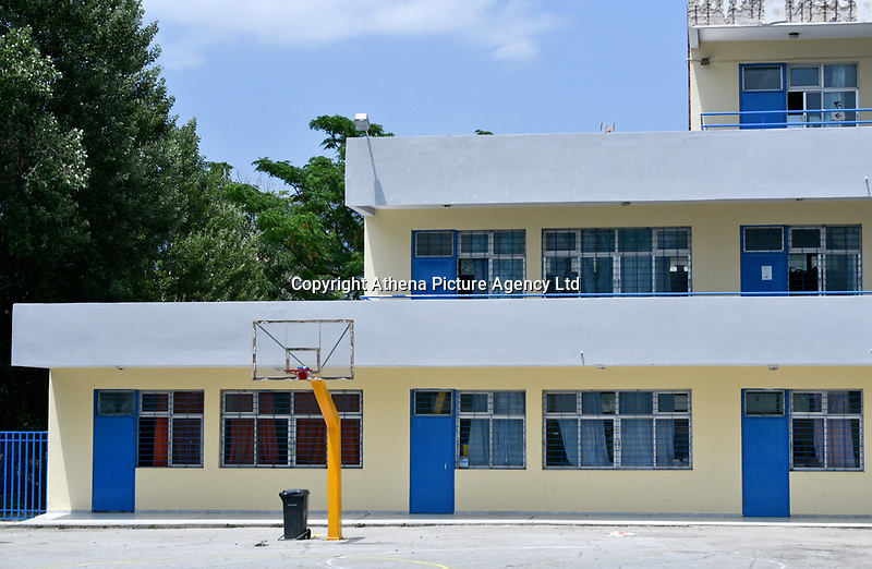 "Pictured: The yard of the 6th Primary School in Acharnes, Athens, Greece. Friday 09 June 2017<br /> Re: An 11 year old boy has been shot dead by a ""stray bullet"" during a school celebration in Acharnes (Menidi) area, in the outskirts of Athens, Greece.<br /> Marios Dimitrios Souloukos ""complained to his mum"" who works as a teacher at the 6th Primary School of Acharnes that he was feeling unwell, he then collapsed with blood pouring out from the top of his head.<br /> His mum tried to revive him assisted by other teachers while his schoolmates who were reportedly upset, were hurriedly removed by their parents.<br /> According to locals an ambulance arrived 25 minutes late.<br /> Hundreds of police officers have been deployed in the area and have raided many properties.<br /> Shells matching the fatal bullet which hit the boy on the top of his head were found in a house yard nearby.<br /> Local people reported hearing shots being fired at a nearby Romany Gypsy camp before the fatal incident.<br /> The area has been plagued with criminality during the last few years."
