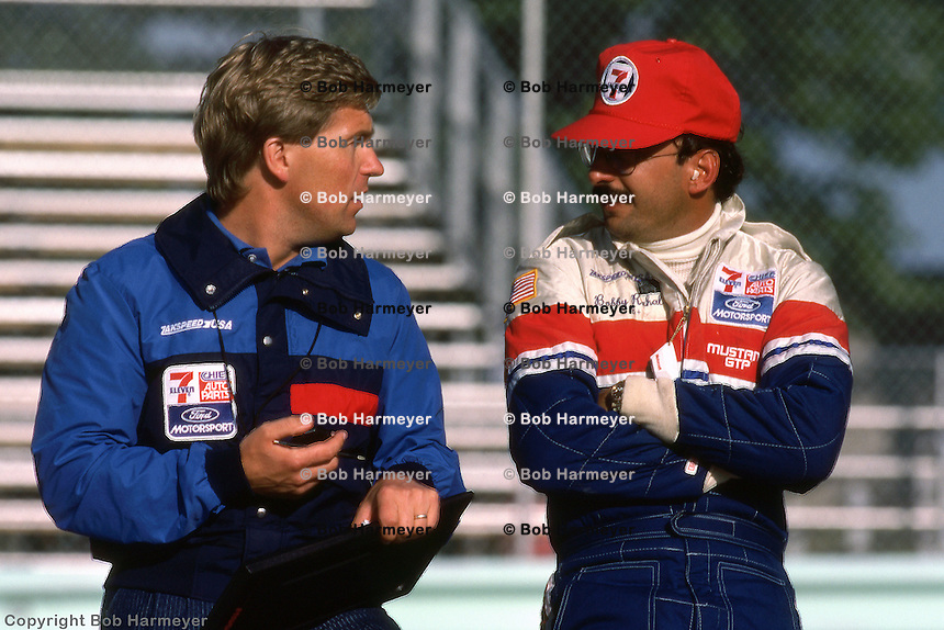 ELKHART LAKE, WI - AUGUST 26:  Bobby Rahal speaks with a crew member during practice for the Budweiser 500 on August 26, 1984, at Road America near Elkhart Lake, Wisconsin.