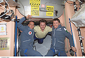 "Two Soyuz Taxi crewmembers, South African space flight participant Mark Shuttleworth (left) and Flight Engineer Roberto Vittori of the European Space Agency (ESA), and cosmonaut Yury I. Onufrienko (center), Expedition Four mission commander, are photographed in the Unity node on the International Space Station (ISS).  The ""taxi"" crew arrived at the orbital outpost on April 27, 2002 at 2:56 a.m. (CDT) as the two vehicles flew over Central Asia. Onufrienko represents Rosaviakosmos. <br /> Credit: NASA via CNP"