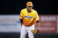 Los Rapidos de Kannapolis relief pitcher Jose Nin (32) looks to his catcher for the sign against the West Virginia Power at Kannapolis Intimidators Stadium on July 25, 2018 in Kannapolis, North Carolina. The Los Rapidos defeated the Power 8-7 in game two of a double-header. (Brian Westerholt/Four Seam Images)