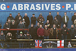 York City 2 Spennymoor Town 2, 20/01/2018. Bootham Crescent, National League North. Spennymoor fans watch the game in front of an advertisement for a local DIY supplier.  Photo by Paul Thompson.