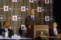 District of Columbia Mayor Adrian Fenty addresses the press, with Victor MacFarlane on his right and William H.C. Chang on his left at the presentation of DC United Holdings as the new group that owns and controls the operating rights for DC United of Major League Soccer, January 8, 2007.