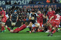 Owen Watkin of Ospreys  is tackled by Rhys Patchell of Scarlets during the Guinness Champions Cup play-off match between the Ospreys and Scarlets at the Liberty Stadium in Swansea, Wales, UK.  Saturday 18 May 2019