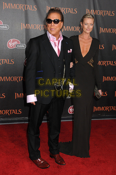 Mickey Rourke and Anastassija Makarenko.The World Premiere of 'Immortals' held at The Nokia Theater Live in Los Angeles, California, USA..November 7th, 2011.full length brown low cut neckline cleavage gold sequins sequined clutch bag black suit waistcoat pink shirt sunglasses shades couple .CAP/ADM/BP.©Byron Purvis/AdMedia/Capital Pictures.