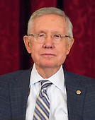 US Senate Minority Leader Harry Reid (Democrat of Nevada) listens to his colleagues speak about him at the ceremony where his official portrait is to be unveiled in the Kennedy Caucus Room on Capitol Hill in Washington, DC on Thursday, December 8, 2016.<br /> Credit: Ron Sachs / CNP