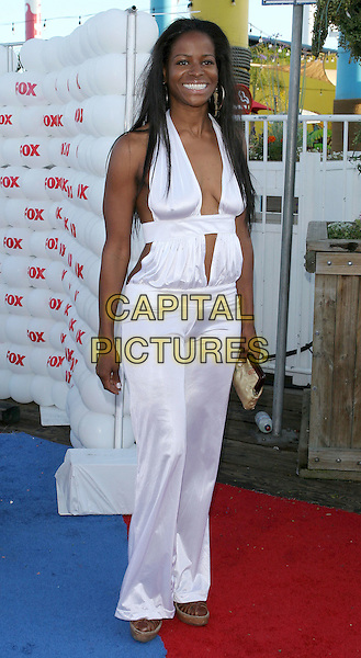 DANIELE GAITHER.Fox TCA Party, .Santa Monica, 29th July 2005.full length white trousers halter neck top gold clutch bag.www.capitalpictures.com.sales@capitalpictures.com.© Capital Pictures.