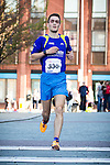 © Joel Goodman - 07973 332324 . 20/09/2015 . Stockport , UK . Winner JAKE LITTLEHALES (23 from Stockport ) crosses the line with a time of 33 minutes 18 seconds . The Big Stockport run from St Petersage in Stockport Town Centre . Photo credit : Joel Goodman