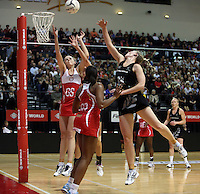 25.10.2012 Silver Ferns Katrina Grant and England's Jo Harten in action during the Silver Ferns v England netball test match as part of the Quad Series played at the TSB Arena Wellington. Mandatory Photo Credit ©Michael Bradley.