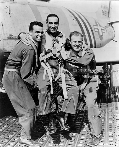 James Jabara, center,  being hoisted.  James Jabara was born in Muskogee, Oklahoma, October 10, 1923.   He was the world's first jet-vs-jet ace.  He  scored his initial victory on April 3, 1951 and his 5th and 6th victories on May 20, 1951. He was then ordered back to the U.S. for special duty. However, at his own request, he returned to Korea in January 1953.  By June, he had shot down nine additional MiG-15s, giving him a total of 15 air-to-air jet victories during the Korean Conflict. Jabara was also credited with 1.5 victories over Europe during World War 2 (The German Luftwaffe had 22 jet pilot aces during World War 2 but all claims were Allied prop-driven aircraft.)  Jabara died in a traffic accident on November 17, 1966.  At the time of his passing, he was the youngest Colonel in the Air Force, was widely rumored to be on the brink of promotion to General..Credit: U.S. Air Force via CNP