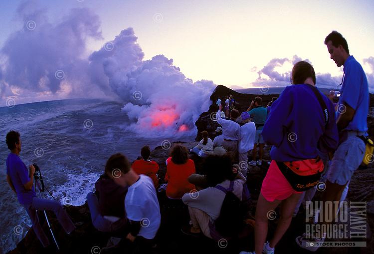 Spectators watching lava explode into Pacific Ocean, Kilauea volcano, Hawaii Volcanoes National Park