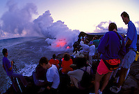 Spectators watching lava explode into Pacific Ocean, Kilauea volcano, Hawaii Volcanoes National Park