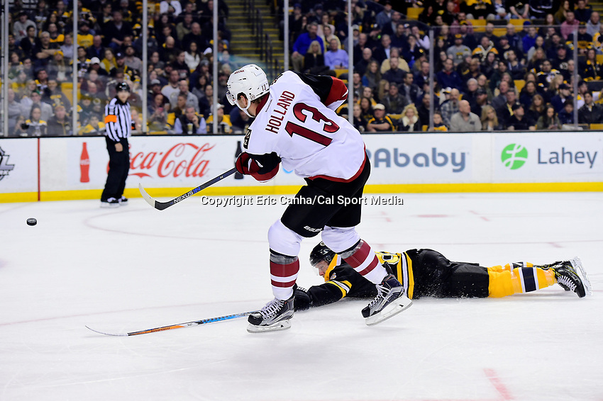 Tuesday, February 28, 2017: Arizona Coyotes center Peter Holland (13) shoots over the stick of Boston Bruins defenseman Kevan Miller (86) during the National Hockey League game between the Arizona Coyotes and the Boston Bruins held at TD Garden, in Boston, Mass. Boston defeats Arizona 4-1. Eric Canha/CSM