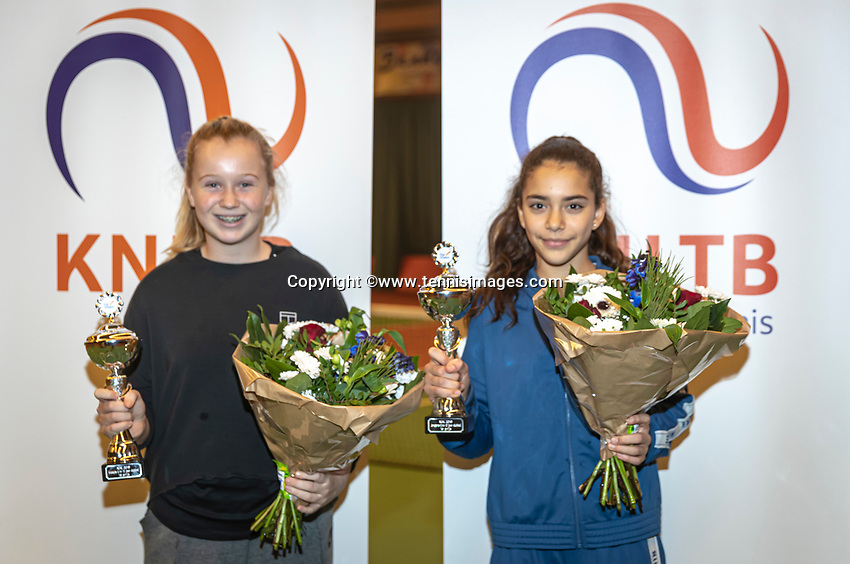 Wateringen, The Netherlands, December 15,  2019, De Rhijenhof , NOJK juniors doubles , Final girls12 years, winners Britt du Pree (NED)  and Lina Ilahi (NED) (R) with the trophy<br /> Photo: www.tennisimages.com/Henk Koster