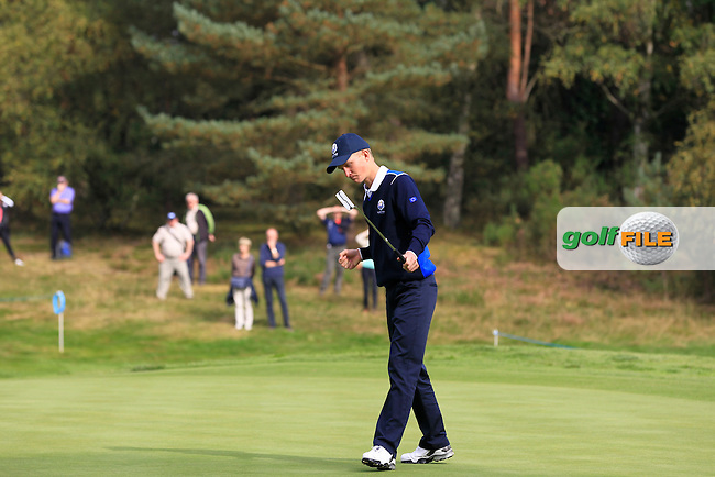 Marcus Kinhult (SWE) on the 1st green of the Mixed Fourballs, puts for a birdie during the 2014 JUNIOR RYDER CUP at the Blairgowrie Golf Club, Perthshire, Scotland. <br /> Picture:  Thos Caffrey / www.golffile.ie