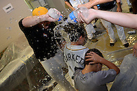 Jacksonville Suns players douse Andy Barkett's son with water after game three of the Southern League Championship Series against the Chattanooga Lookouts on September 12, 2014 at Bragan Field in Jacksonville, Florida.  Jacksonville defeated Chattanooga 6-1 to sweep three games to none.  (Mike Janes/Four Seam Images)