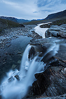 Waterfall flows near Tjäktja hut, Kungsleden trail, Lapland, Sweden