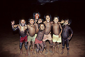 A-Ukre village, Brazil. A group of Kayapo boys pretending to be wild animals! Xingu Indigenous Area, Para state.
