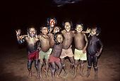 A-Ukre village, Brazil. A group of Kayapo boys pretending to be wild animals! Xingu Indigenous Area, Para state.
