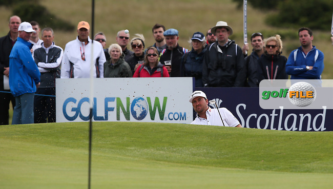 Graeme McDowell (NIR) playing from the bunker on the 10th during Round Three of the 2015 Aberdeen Asset Management Scottish Open, played at Gullane Golf Club, Gullane, East Lothian, Scotland. /11/07/2015/. Picture: Golffile | David Lloyd<br /> <br /> All photos usage must carry mandatory copyright credit (&copy; Golffile | David Lloyd)