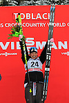 USA Jessica Diggins at the podium of the 5 Km Individual Free race of Tour de ski as part of the FIS Cross Country Ski World Cup  in Dobbiaco, Toblach, on January 8, 2016. American Jessica Diggins wins the race, ahead of Norway's Heidi Weng and third place for actual leader Ingvild Flugstad Oestberg from Norway. Credit: Pierre Teyssot
