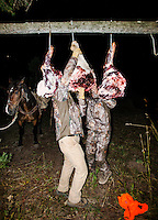 Outdoor Life Editor Andrew McKean and hunter Mike Stock hang meat to cure after a mule deer hunt at Trefren Outfitters on Greyback Ridge in the Hoeback Drainage of Wyoming Region H, outside of Alpine, Wyoming, Tuesday, September 22, 2015. <br /> <br /> Photo by Matt Nager