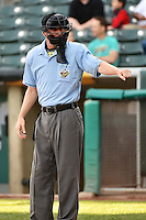 Home plate umpire Scott Mahoney during the game between the Fresno Grizzlies and the Salt Lake Bees at Smith's Ballpark on April 9, 2014 in Salt Lake City, Utah.  (Stephen Smith/Four Seam Images)