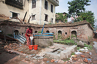 A woman collects water from a source in Shanku, near Kathmandu, Nepal. May 9, 2015
