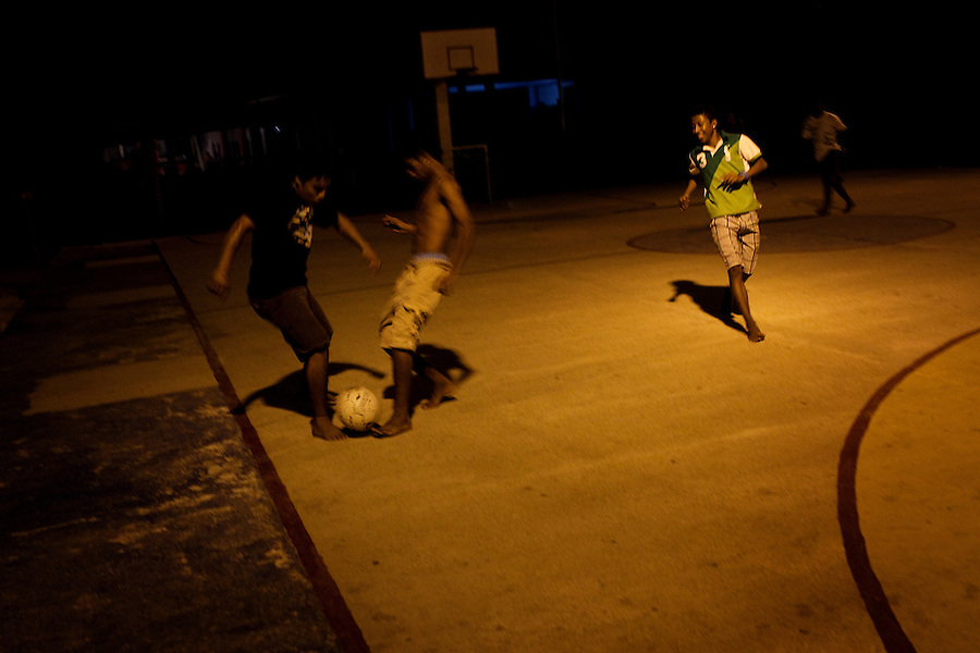 Acapulco, Mexico, February 17, 2012 – A group of boys play soccer at night in the community on the Bahia De Puerto Marquez.