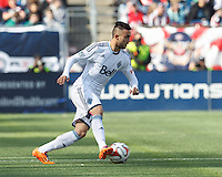 Vancouver Whitecaps FC substitute midfielder Pedro Morales (77) dribbles at midfield.  In a Major League Soccer (MLS) match, the New England Revolution (blue/white) tied Vancouver Whitecaps FC (white), 0-0, at Gillette Stadium on March 22, 2014.