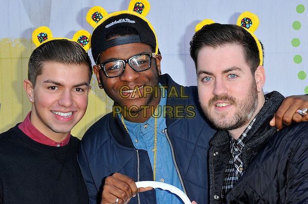Loveable Rogues.BBC Children In Need's Pudsey Street -photocall, New Piazza, Covent Garden, London, England..3rd November 2012.half length Eddie Brett, Sonny Jay, Te Eugene Qhairo glasses hat beard facial hair black blue .CAP/CJ.©Chris Joseph/Capital Pictures.