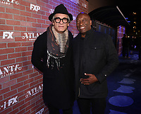 """LOS ANGELES - FEBRUARY 19: Alon Abutbul and John Singleton arrives at the red carpet event for FX's """"Atlanta Robbin' Season"""" at the Ace Theatre on February 19, 2018 in Los Angeles, California.(Photo by Frank Micelotta/FX/PictureGroup)"""
