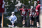 14 February 2015: UMass's Andrew Sokol (19) celebrates scoring a goal past North Carolina's Brian Balkam (30) with UMass's Nick Mariano (23). The University of North Carolina Tar Heels hosted the University of Massachusetts Minutemen in a 2015 NCAA Division I Men's Lacrosse match. UNC won the game 20-8.