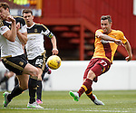 Scott McDonald has a wild shot