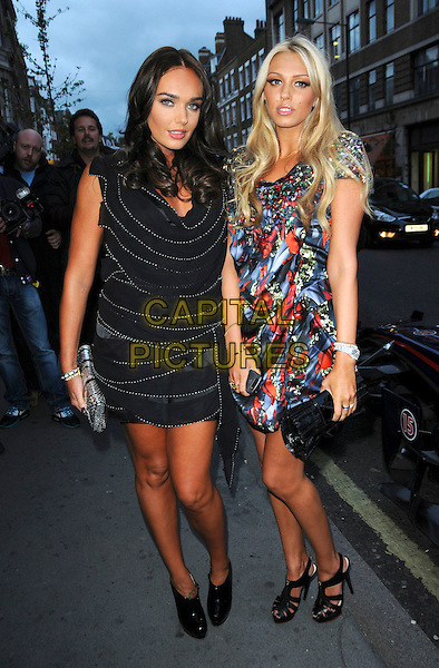 TAMARA ECCLESTONE & PETRA ECCLESTONE.Arriving for the Form luxury menswear collection launch party, London, England, UK, September 7th 2009..full length sisters family black dress print red blue embellished jewel encrusted stones  clutch bag shoes sandals ankle boots cut out silver .CAP/CAS.©Bob Cass/Capital Pictures.