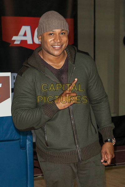 LL Cool J (James Todd Smith)<br /> Teams up with ACE Brand to launch the ACE Brand &quot;A&quot; Game Challenge, New York City, NY., USA.<br /> October 7th, 2013 <br /> half length green jacket beanie hat hand finger pointing <br /> CAP/MPI/COR<br /> &copy;Corredor99/ MediaPunch/Capital Pictures