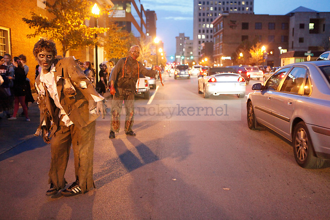 "Derek Wise, left, and Dale Jennings act as ""Office Bob"" and ""Intestine Zombie"" before the Thriller Parade in downtown Lexington Friday night..Photo by Zach Brake 